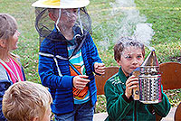 Excited children learning about beekeeping
